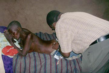 Dr. Moses giving medical assistance to the poorest of the poor