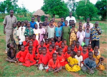John Olupot with orphans he looks after